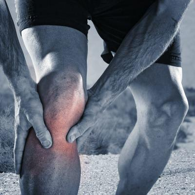 runner with knee pain due to biomechanical issues.